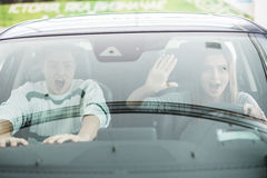 Couple in a car about to have a crash. Woman drive a car. Stock Photos