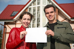 Couple with card and house Stock Photography