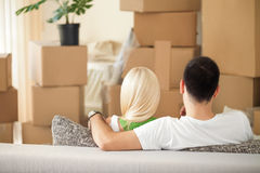 Couple with cardboard boxes Stock Image