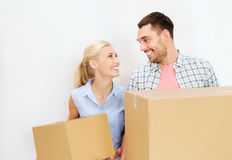 Couple with cardboard boxes moving to new home Stock Image