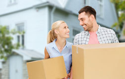 Couple with cardboard boxes moving to new home Royalty Free Stock Image
