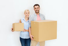 Couple with cardboard boxes moving to new home Stock Photo