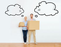 Couple with cardboard boxes moving to new home Royalty Free Stock Photos