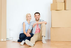 Couple with cardboard boxes moving to new home Stock Images