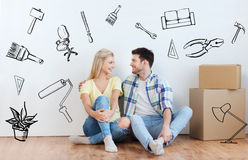 Couple with cardboard boxes moving to new home Royalty Free Stock Images