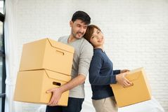 Couple with cardboard boxes at new home. Happy Young Couple with cardboard boxes at new home. Moving house royalty free stock photo