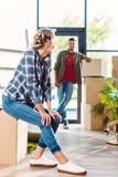 Couple with cardboard boxes in new house Royalty Free Stock Photos