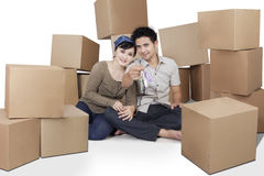 Couple with cardboards show house key Stock Photos