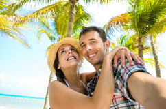 Couple on caribbean travel taking selfie photo. Couple on summer tropical vacation taking selfie photo on the beach. Man and women on Mexico caribbean travel royalty free stock photos