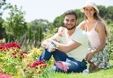 Couple caring their garden Stock Images