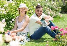 Couple caring their garden Stock Photo