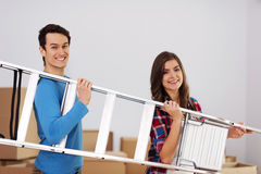 Couple carring a ladder Stock Photos