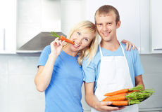 Couple with carrots Royalty Free Stock Photos