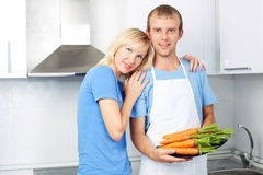 Couple with carrots Royalty Free Stock Photo