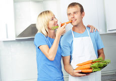Couple with carrots Royalty Free Stock Image