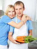 Couple with carrots Stock Photos