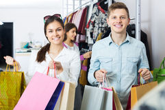 Couple carrying bags in boutique Stock Photography