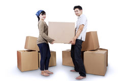 Couple carrying box isolated Royalty Free Stock Photo