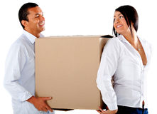 Couple carrying boxes Stock Image
