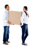 Couple carrying boxes Stock Images