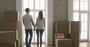 Couple Carrying Boxes Into New Home or new apartment On Moving Day. Happy family moving into their new home and Carrying Boxes stock video footage