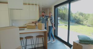 Couple carrying boxes into new home on moving day. Couple carrying boxes into new home on moving day stock video