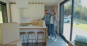 Couple Carrying Boxes Into New Home On Moving Day. Couple Carrying Boxes Into New Home On Moving Day stock video footage