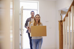 Couple Carrying Boxes Into New Home On Moving Day stock photography