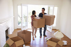 Couple Carrying Boxes Into New Home On Moving Day Stock Image