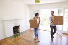 Couple Carrying Boxes Into New Home On Moving Day Royalty Free Stock Photos
