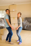 Couple carrying boxes Royalty Free Stock Image