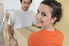 Couple carrying brown boxes Stock Image
