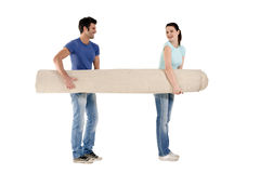 Couple carrying a carpet Stock Photography