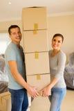 Couple carrying carton boxes Stock Photos