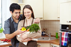 Couple carrying groceries Royalty Free Stock Image