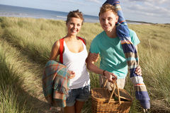 Couple Carrying Picnic Basket Walking Throug Stock Photos