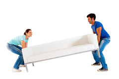 Couple carrying a sofa Royalty Free Stock Photography