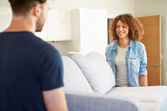 Couple Carrying Sofa As They Move Into New Home Royalty Free Stock Photos