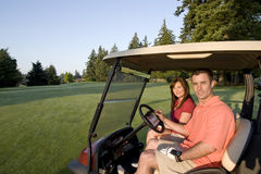 Couple in Cart on Golf Course - Horizontal Stock Images