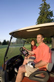 Couple in Cart on Golf Course - Vertical Stock Photos