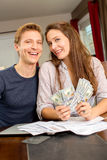 Couple with cash Royalty Free Stock Images