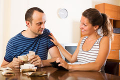 Couple with cash at home Royalty Free Stock Photo