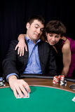 Couple in the casino. Playing poker on green felt Stock Images