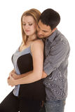 Couple casual his arms around her eyes down Royalty Free Stock Photos