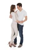Couple In Casuals Embracing Over White Background Royalty Free Stock Photography