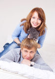 Couple with a cat Stock Photography