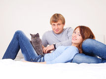 Couple with a cat royalty free stock photos