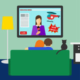 Couple and cat watching the breaking news on television Royalty Free Stock Images