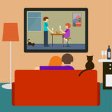 Couple and cat watching the romantic movie on television Stock Image