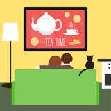 Couple and cat watching television Stock Images